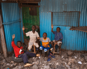 African Boys Waving